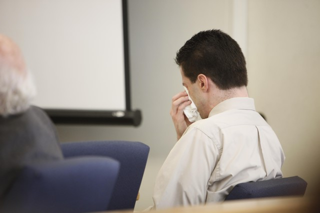 Nicholas McGuffin sheds tears at his trial in 2011.