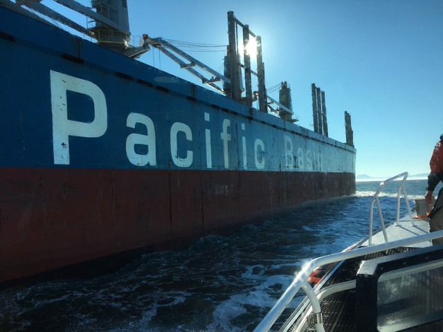 Columbia River Bar pilots board huge shipping vessels to help them cross the treacherous water safely.