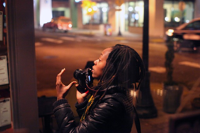 Photographer Intisar Abioto stages a photo for The Black Portlanders on a cold evening on Alberta Street in Northeast Portland.