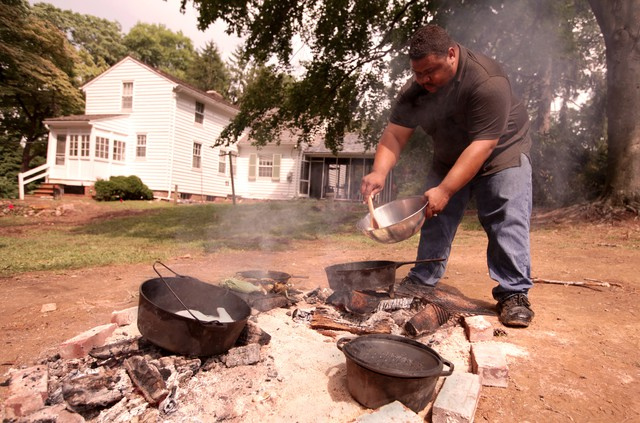 Culinary historian Michael Twitty prepares food at the plantation site where Josiah Henson, who inspired the title character in Uncle Tom's Cabin, lived and worked.