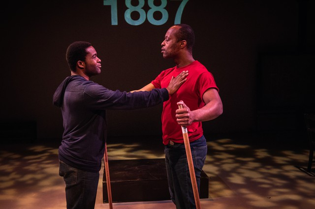 "Vim Shambry as ""Actor 2/Black Man"" and Joseph Gibson as ""Actor 4/Another Black Man"" reenact the history of the Herero tribe (at least as they imagine it) in a play that asks: ""how can we know the history of people who left little trace."""