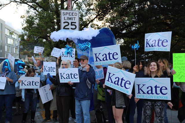Supporters of Gov. Kate Brown demonstrate in Portland outside of the third and final gubernatorial debate of the 2018 campaign.