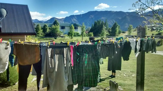 Hang drying clothes saves energy over putting them in a clothes drier.