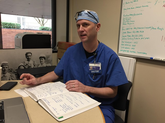 Dr. Brian Chesebro uses a large ledger to keep track of his research, just like his father, who was a scientist.