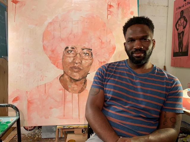 """Jeremy Okai Davis in his SE Portland studio with the painting """"Metering"""" from his show """"Presence of Color."""""""