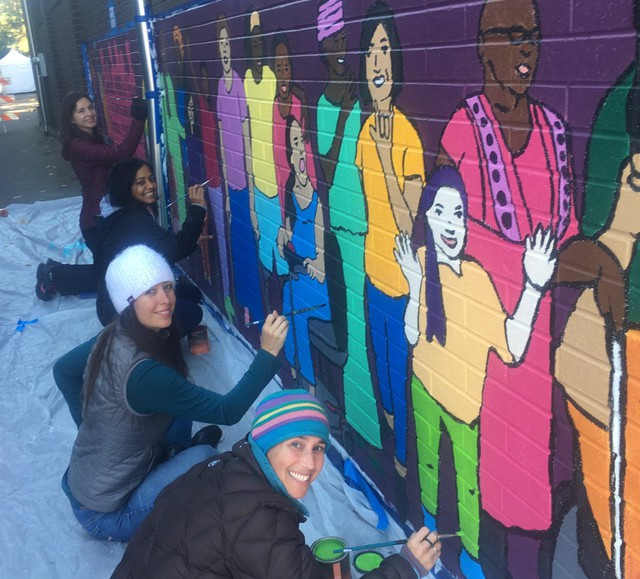 Mobility International USA's mural, in process, in downtown Eugene.