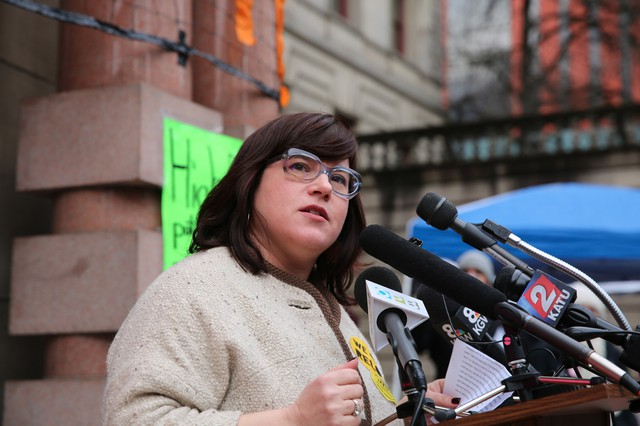 Portland Commissioner Chloe Eudaly speaks to supporters of a renter relocation aid bill on the steps of city hall in 2017.