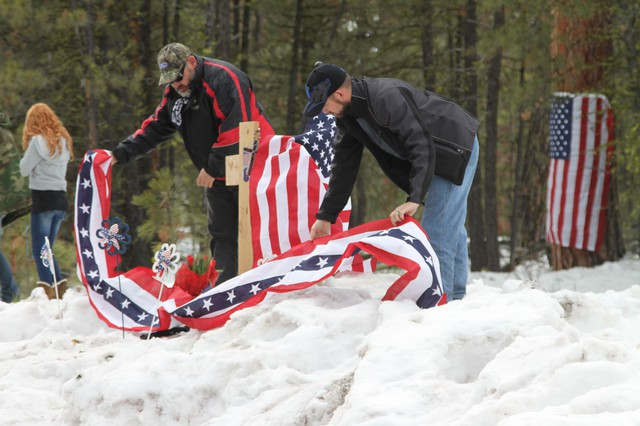 Pacific Patriots Network co-founder B.J. Soper, right, helps rebuild the roadside memorial to deceased militant LaVoy Finicum.