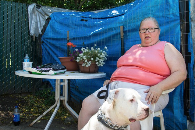 """Renae Corbett lives at Oak Leaf with her 80-year-old father and two dogs. """"It works for me. The price is right,"""" she says."""
