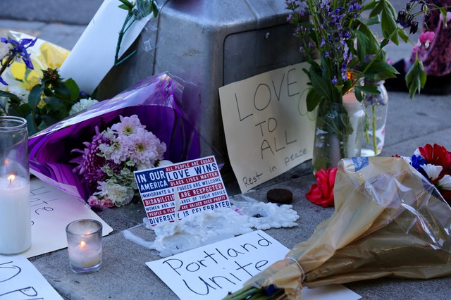 Community members have created a memorial for victims of Friday's attack at the Hollywood MAX station. A candlelight vigil is planned for Saturday night.
