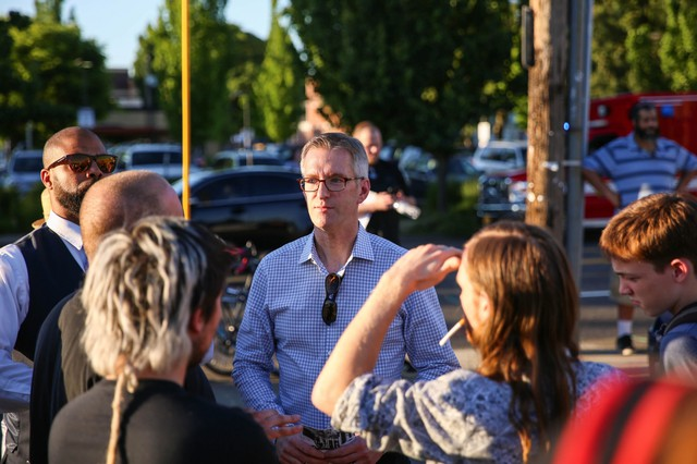 Portland Mayor Ted Wheeler speaks with citizens at the Hollywood vigil.