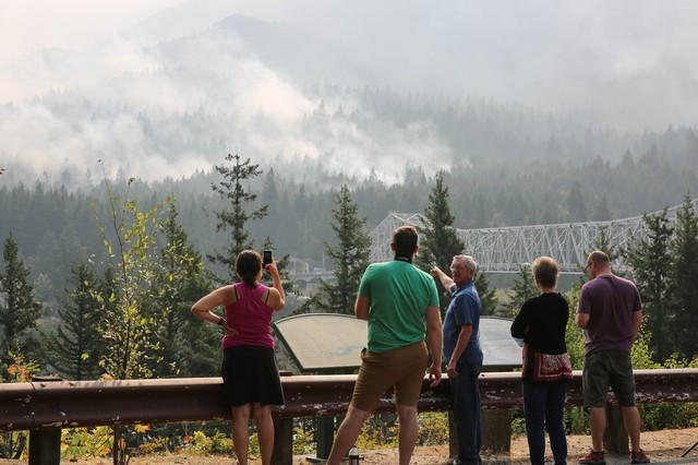 People view the Eagle Creek Fire from across the Columbia River in Stevenson, Wash., Sept. 8, 2017.