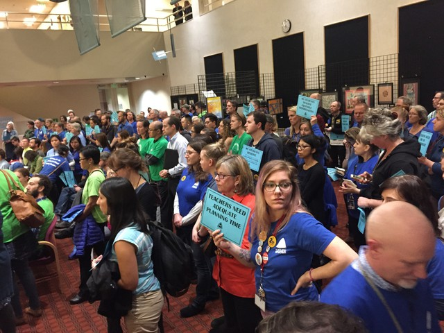 Portland teachers in blue T-shirts and ACCESS Academy parents in green packed the Portland Public Schools board meeting Oct. 24, 2017.