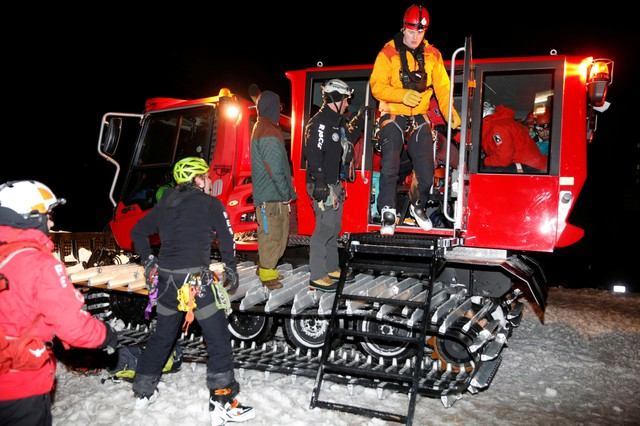 Rescuers with Portland Mountain Rescue and the 304th Air Force Reserve Rescue Squadron unload after helping climbers descend from Mount Hood, Feb. 13, 2018.