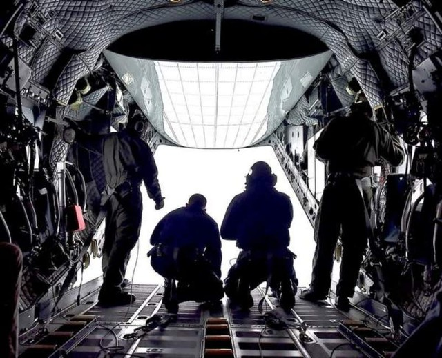 A Coast Guard crewmonitors the crab fleet at the mouth of the Columbia River from a C-27 aircraft.