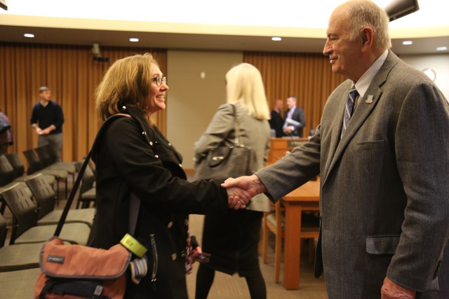 Vancouver City Councilor Bill Turlay congratulates Laurie Lebowsky, who was appointed to the city council at a special meeting on Monday Feb. 5.