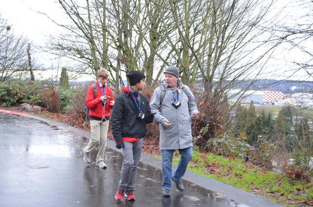 Two Cleveland High School students, Brandon Teeny and John Hoac, and Western Washington University Professor Troy Abel are measuring pollution on the Cleveland campus in south Seattle.