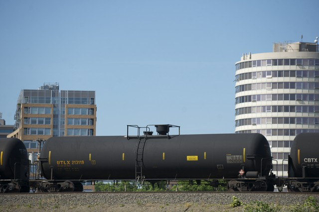 An oil train passes through Vancouver. The Vancouver City Council on Thursday unanimously passed an emergency six-month moratorium on new or expanded facilities that would accept crude oil.