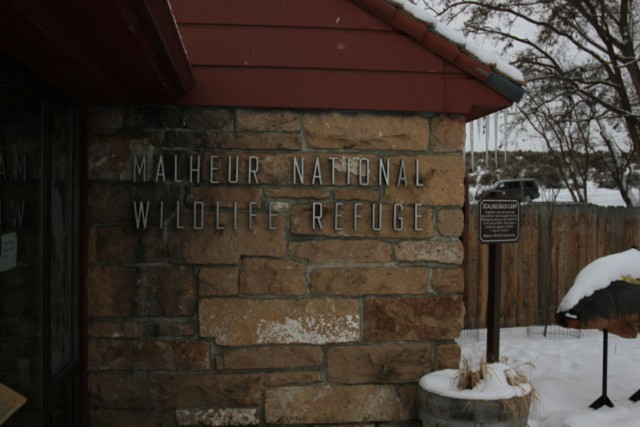 Snow blankets a building at the Malheur Wildlife Refuge.