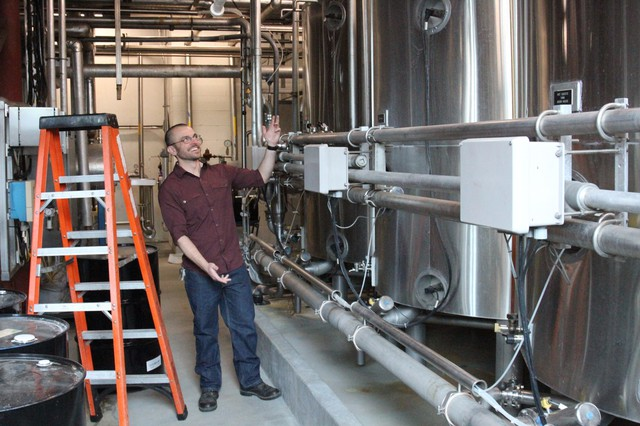 Ryan Reid with Deschutes Brewery shows off one of the brew kettles at the flagship brewery in Bend.