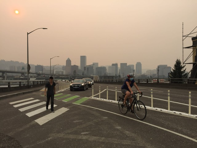 Smoke from the Eagle Creek wildfire darkens the skies in downtown Portland.