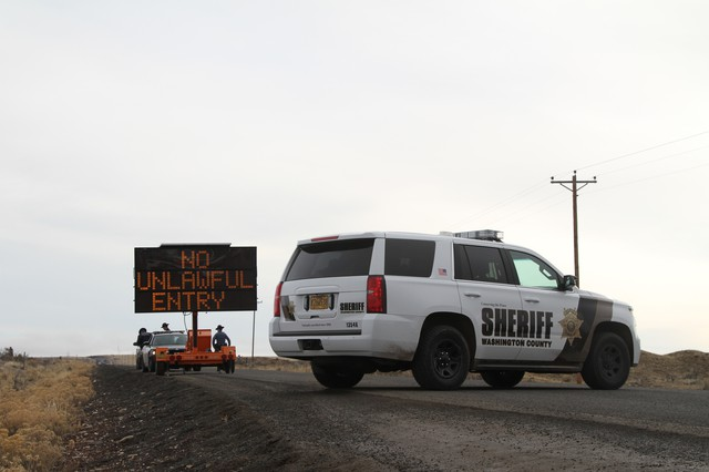 A Washington County Sheriff's vehicle blocks the road leading to the Malheur National Wildlife Refuge. The 41-day armed occupation of the refuge ended Thursday, Feb. 11.