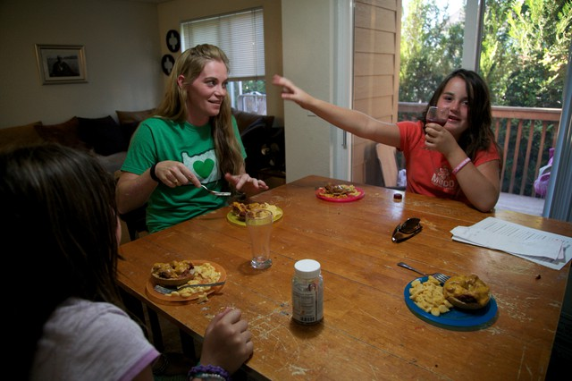 Tiffany Warner eats dinner at home with her two daughters in Bend.