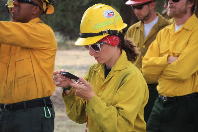Brna practices using a compass during guard school, a week-long training course for new firefighters.