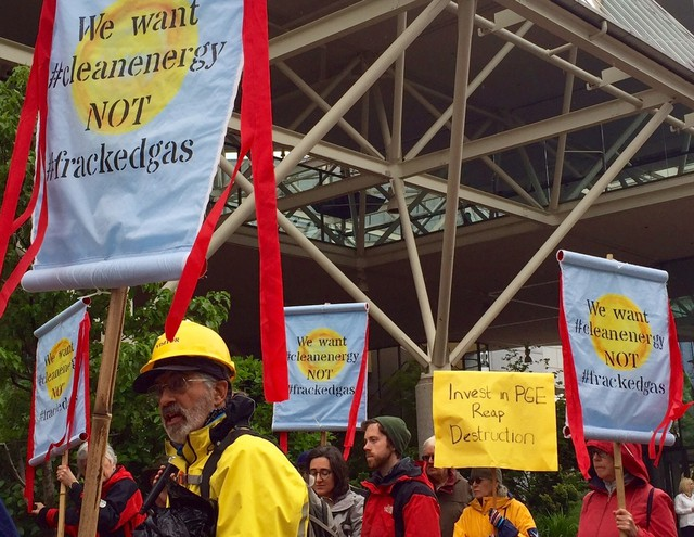 Environmental groups gathered outside a Portland General Electric shareholders meeting Wednesday to protest the utility's plans to consider building two new natural gas power plants in Boardman.