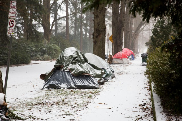 Tents gather snow during a winter storm on Saturday, Jan. 7, 2017. Of fiveoccupants interviewed, none knew the location of warming shelters, and only one expressed interest in going.