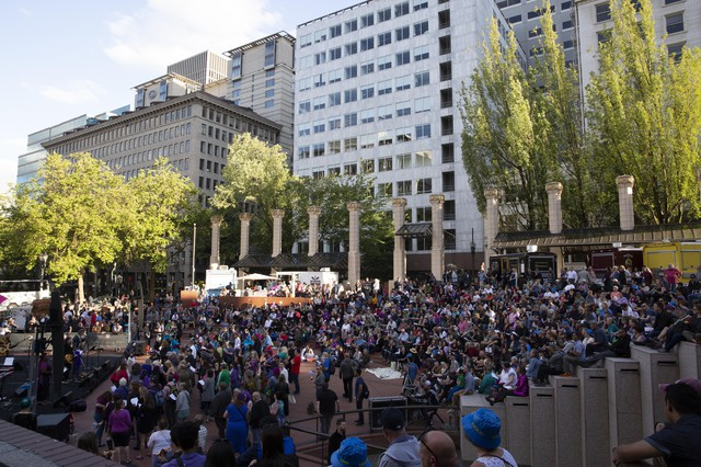 An estimated 2,000 people filled Pioneer Courthouse Square throughout the evening for Low Bar Chorale's Purple Rain sing.