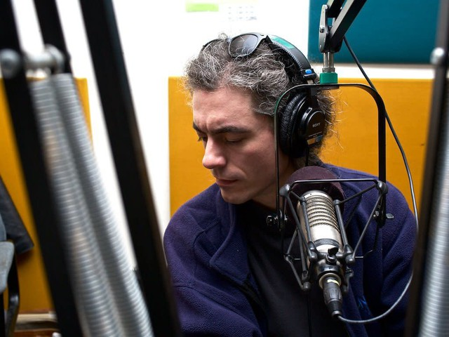 KBOO volunteer Sam Parrish does board engineering for a variety of programs at the station.