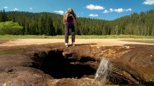 Terry McDermott takes photos at the hole at Lost Lake.