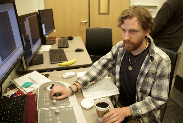 Greg Martin, a student in the Biochemistry and Molecular Biology Graduate Program, works on an older version of the new cryo-electron microscopes.