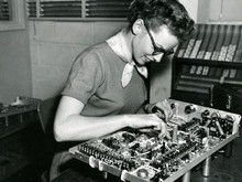 Woman assembling scope, ca 1950s