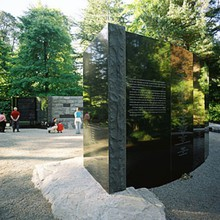 Volunteers from the Oregon Holocaust Resource Center clean the polished granite of the Oregon Holocaust Memorial in Washington Park.