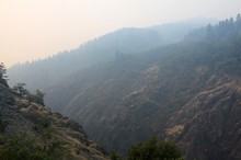 Wildfire smoke hovered over the Rogue River Canyon earlier this year.