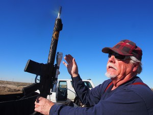 Jerry Frederick shows off one of two personalized AR rifles he had built by Unique ARs, an Idaho company that specializes in custom AR rifles. The AR has become the most popular rifle in America and one of the most controversial.