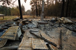 A burned cabin that was destroyed in Washington's 2014 Carlton Complex wildfire.