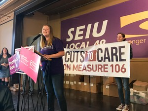 "Grayson Dempsey at a Portland rally for canvassers fighting Measure 106. Dempsey heads the Oregon chapter of NARAL pro-choice America and is a leader of ""No Cuts To Care,"" the opposition campaign."