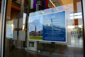 A flyer with Clark College's non-discrimination policy hangs on several doors and classrooms on campus.