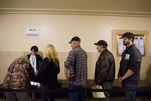 Opponents of Senate Bill 978 sign in before public testimony at the Capitol in Salem, Ore., Tuesday, April 2, 2019. An amendment to the bill before the Senate judiciary committee requires safe storage of firearms, allows retailers to refuse some gun sales and more.
