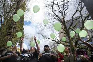 Larnell Bruce Jr.'s family releases green balloons after the sentencing hearing of Russell Courtier on April 16, 2019, in Portland, Ore.