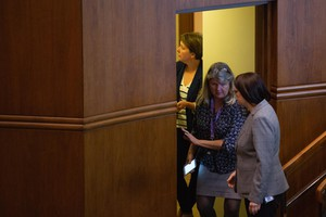 Sen. Sara Gelser, D-Corvalis, meets with aides and other senators behind the chamber of the Senate.
