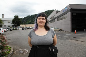 Carsen Harrison-Bower stands behind Amazon's Northwest Portland delivery station on July 17, 2019. She said, without air conditioning, it gets very warm in the summer.