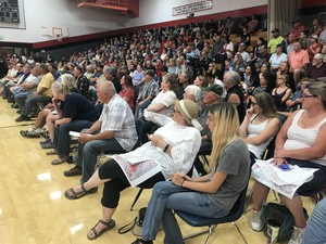 More than 500 people gathered at a community meeting at Glendale High School in Douglas County, Ore., to discuss the Milepost 97 fire, Sunday, July 28, 2019.