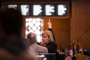 House Majority Leader Jennifer Williamson, D-Portland, signals her vote on the House floor at the Capitol in Salem, Ore., Tuesday, April 2, 2019.