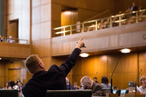 State Rep. Daniel Bonham, R-The Dalles, points to the gallery from the House floor at the Capitol in Salem, Ore., Thursday, April 11, 2019.