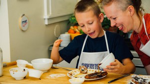 Born without a left hand, Alexis Hillyard, right, inspires people to celebrate their limb differences and embrace cooking through her YouTube channel Stump Kitchen.
