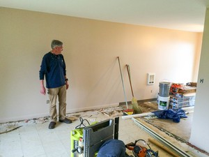 Mark Bidwell examines repairs to a unit at the Keizer apartment complex he owns with his wife.
